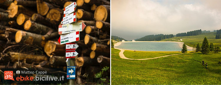 foto della segnaletica dell'Alpe cimbra bike e il lago Coe.