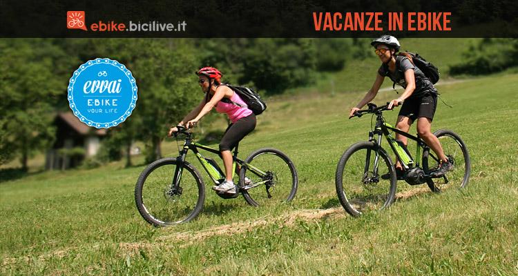 cicliste in vacanze in ebike in trentino con evvai