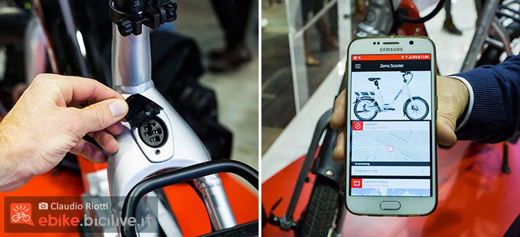 foto della L'ebike Zemo powered by Vodafone con la sua presa per la ricarica e l'app scaricabile sullo smartphone.
