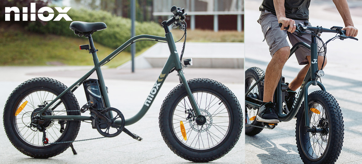 Un uomo in sella a una e-bike fat Nilox J3 dal catalogo 2021