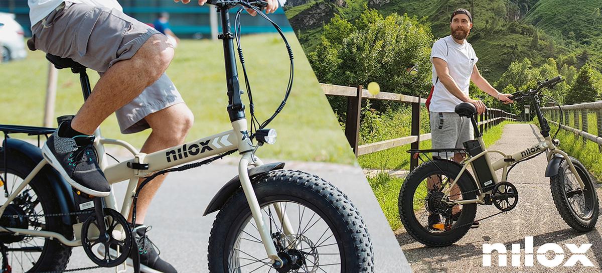 Un ciclista nella Natura con una ebike pieghevole fat Nilox X8 2021